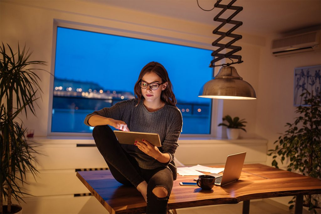 Woman working after hours with a tablet